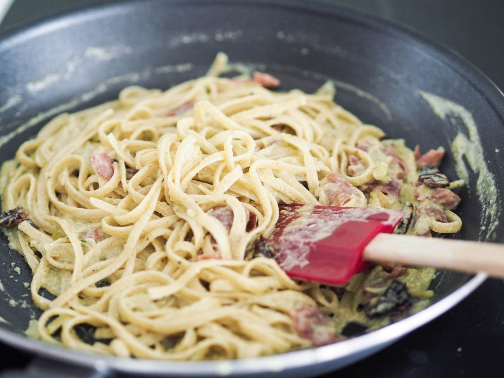 mixed pesto pasta in a pan